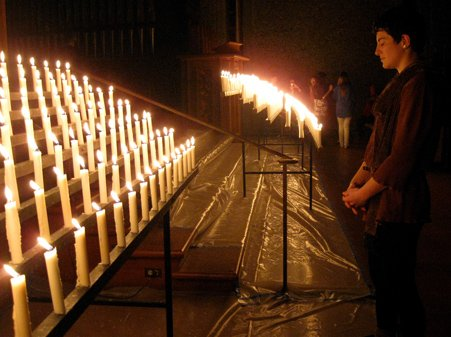 Rows of lit candles